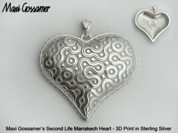 By Maxi Gossamer.  Sterling silver heart, 3D printed.