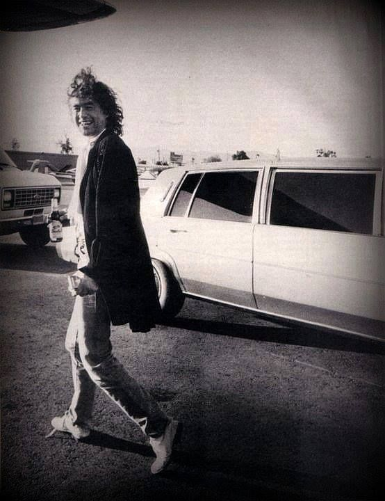 Jimmy Page of Led Zeppelin - limo and stone washed jeans