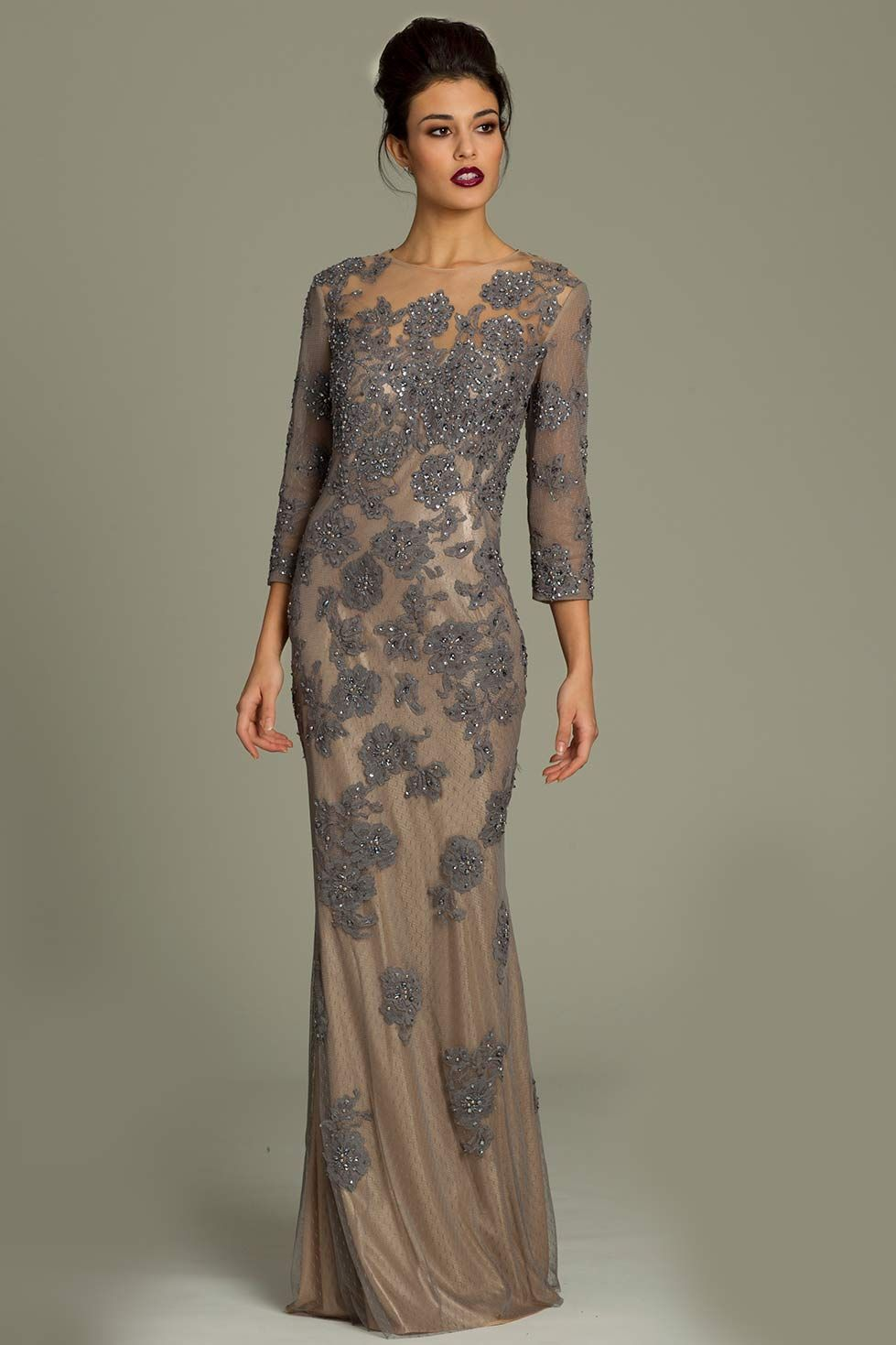 bc97ff8f38e Jovani Long sleeve lace gown featuring a sheer net lace applique overlay.