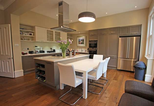 Shaker Kitchen With Large Kitchen Island Finished In Beige Grey