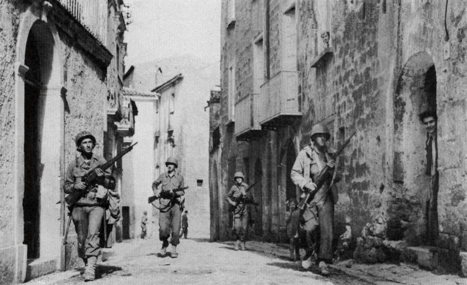 U.S. soldiers of the 34th Infantry Division patrolling over the ancient street…