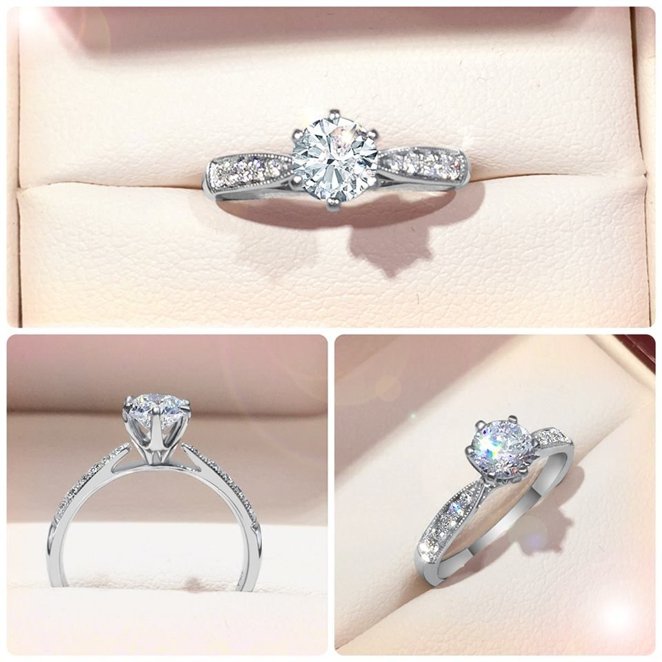 Simplistic 6 claw Engagement ring with milgrain tapered band This