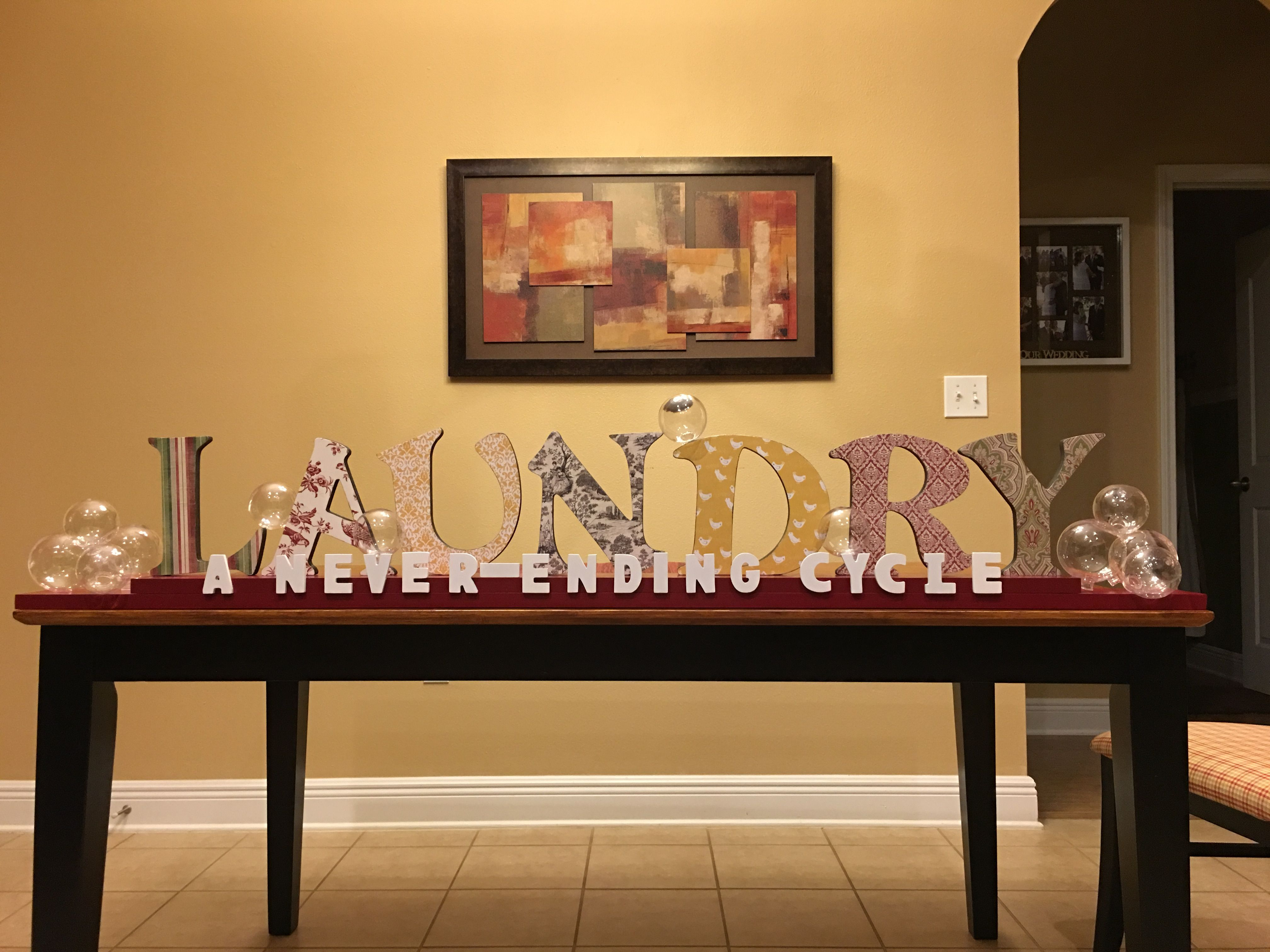 How to glue scrapbook paper to wood letters - Laundry Room Decor Diy Laundry Room Sign Made With Wood Letters From Joanne S Used