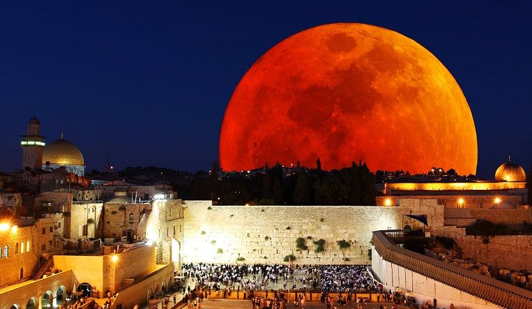 What do four consecutive blood moons on the Jewish holidays of Passover and Sukkot mean for the Jews and the world at large?