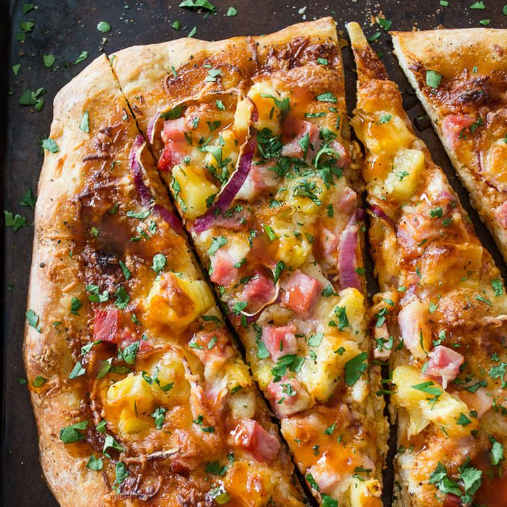 BBQ Hawaiian Pizza Recipe Main Dishes with pizza doughs, bbq sauce, shredded mozzarella cheese, diced ham, fresh pineapple, purple onion, kosher salt, pepper, chopped cilantro
