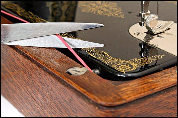 Singer sewing machine head and base reassembly