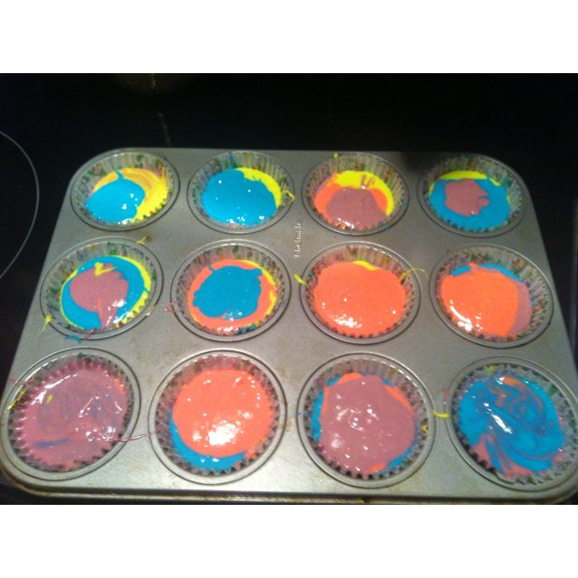 In the process of making rainbow cupcakes.