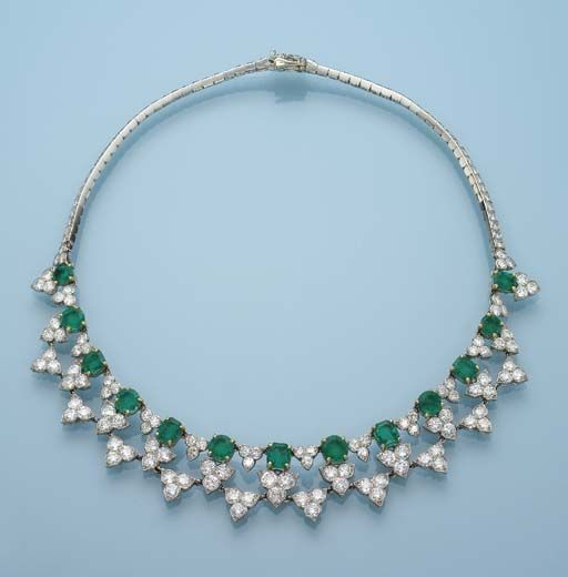 AN EMERALD AND DIAMOND NECKLACE, BY CARTIER Designed as a fringe of emeralds and diamond trefoils to the collet-set diamond line, circa 1955, 36.0 cm long, with French assay marks for platinum and gold Signed Cartier Paris, no. 03341