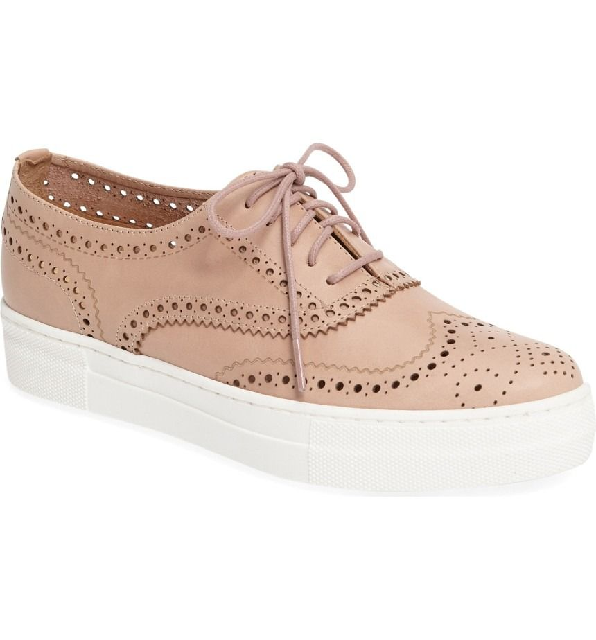Wingtip-inspired perforations add a menswear twist to this casual sneaker with a softly pointed toe and a bumper platform cupsole.