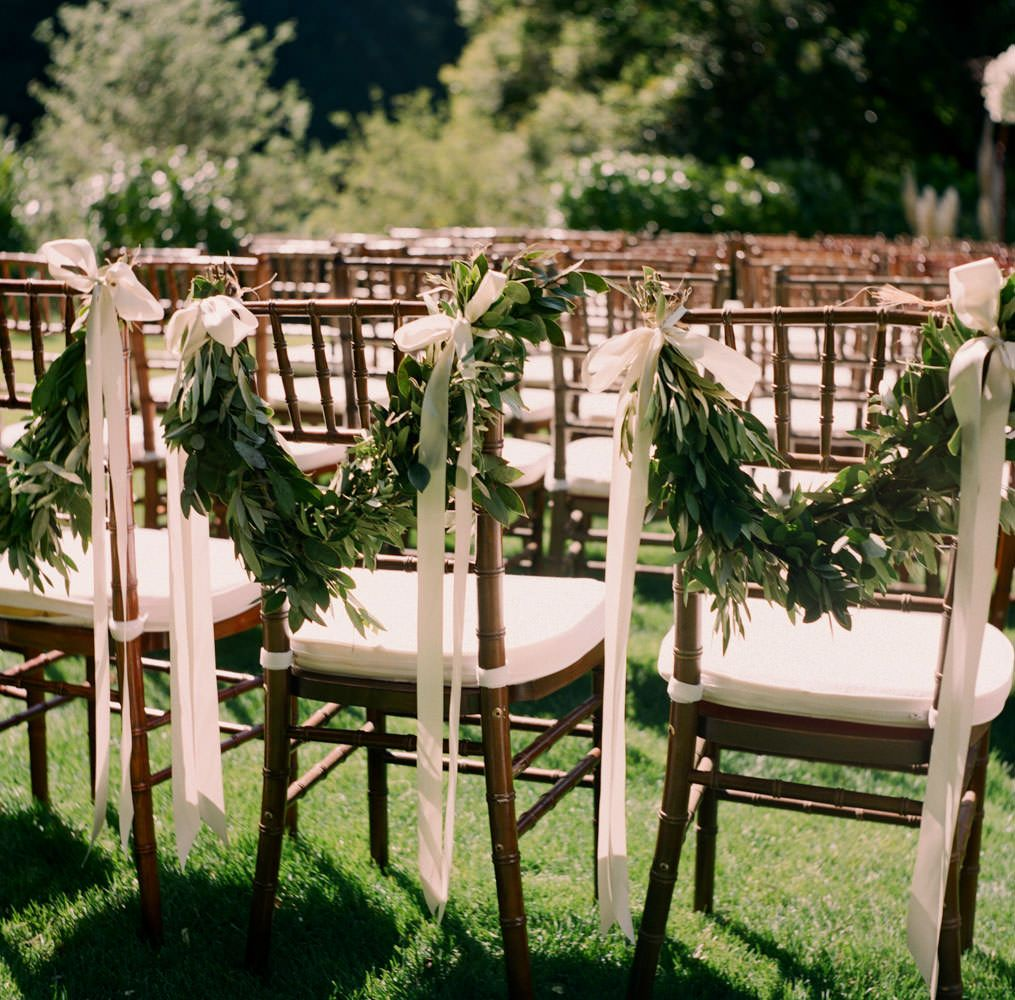 Wedding garden chairs - Gia Canali Photography Garden Wedding Ceremony Olive Leaf Garlands For Ceremony Seating