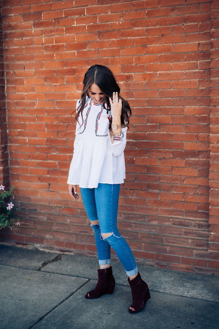 Love this fall look. Peep toe booties, distressed denim, and an embroidered peplum top.