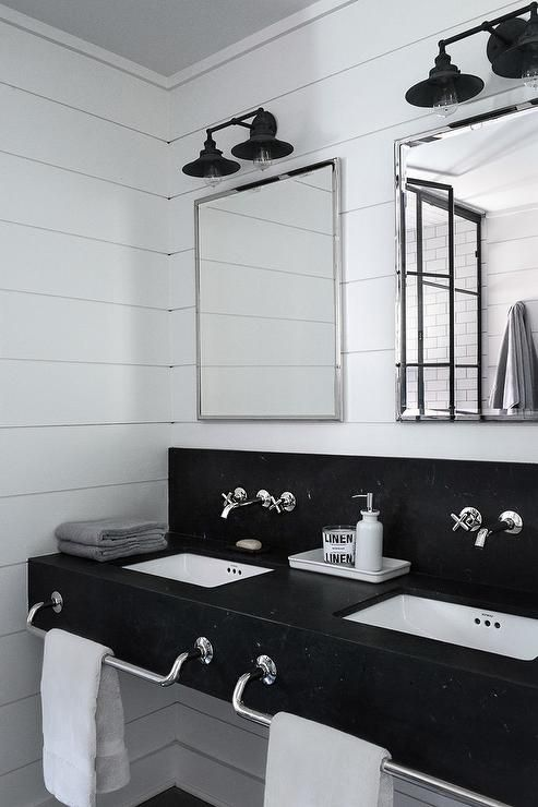 Black And White Industrial Bathroom Features A Honed Black