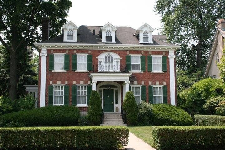 Red Brick Green Shutters White Trim Clipped Hedges Dormers