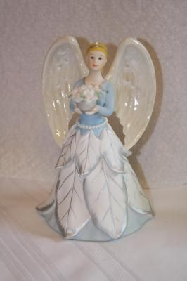 "Avon Angel,porcelain. $5 **missing a couple small pearls & coating coming off a couple. Pedal and leaf are chipped** measures 6"" x 4""D"