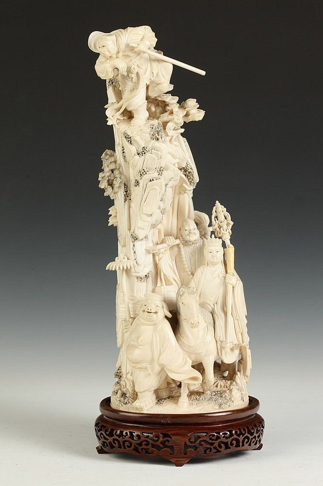 CHINESE IVORY FIGURAL GROUP OF XI YOU JI (JOURNEY TO THE WEST). Carved to depict Tang Xuanzang with his three disciples, Sun Wukong, Zhu Bajie, and Sha Wujing, and the white dragon horse - 14 in. high.  Notes: Provenance: Private collection of David G. Tarlow, acquired in the 1960s.
