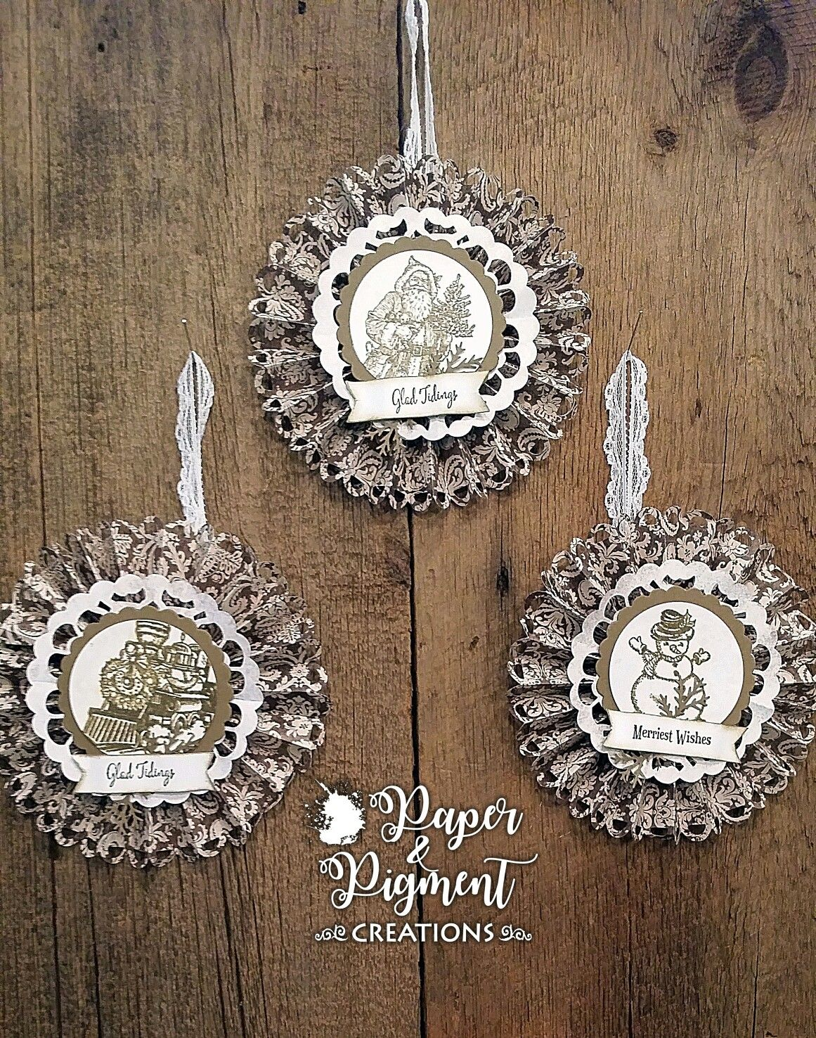 Vintage ornaments using Stampin Up Christmas Magic, Father Christmas, and Merriest Wishes Stamp Sets.  Soft Suede and Shimmer White Cardstocks.   Soft Suede Ink. Rosettes made with DSP from Hobby Lobby.
