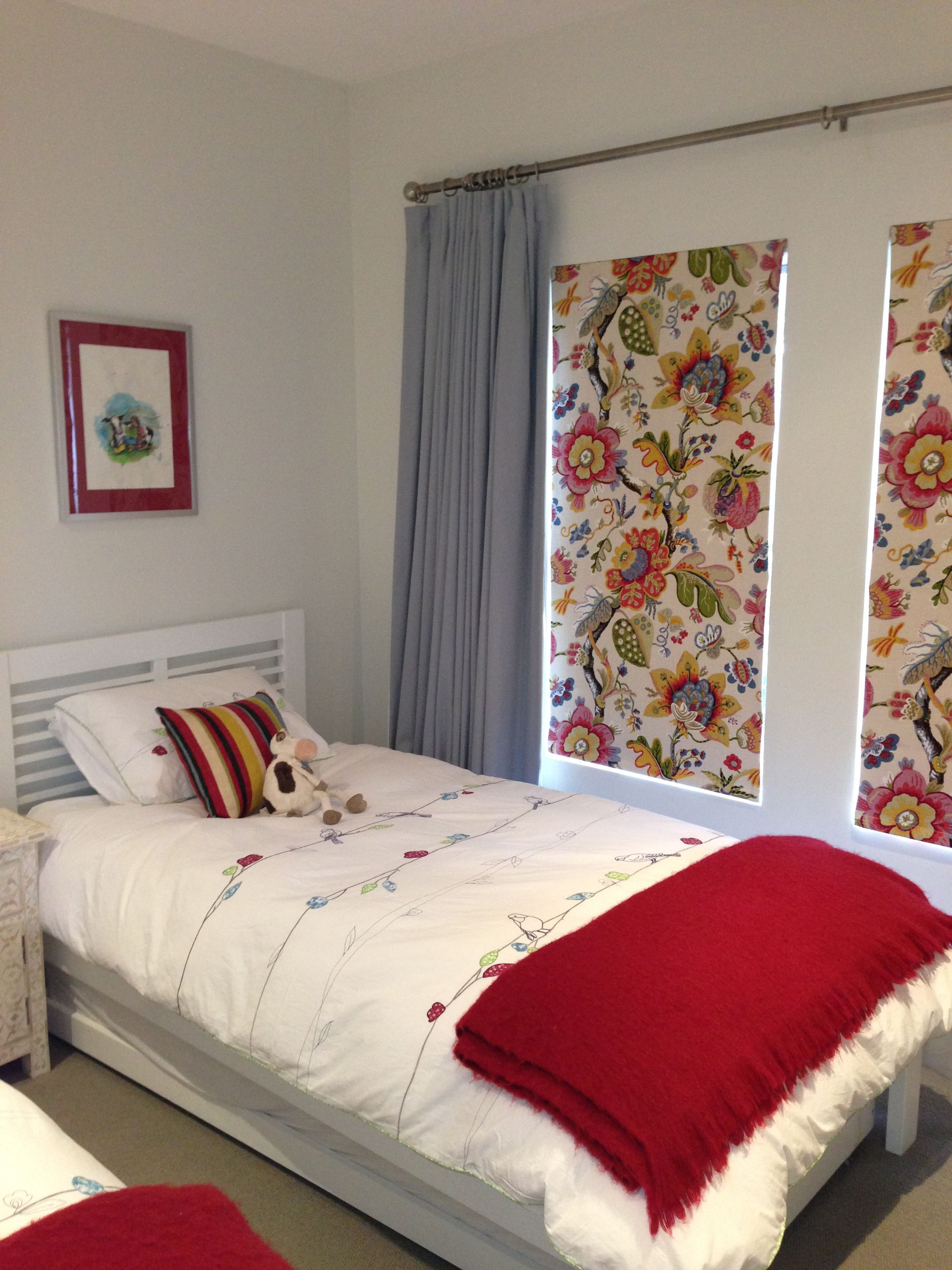 Bed head against window  roman blinds and curtains together with wooden bedhead all by