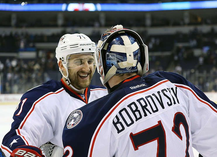 WINNIPEG, MB - DECEMBER 29: Nick Foligno #71 and goaltender Sergei Bobrovsky #72 of the Columbus Blue Jackets celebrate a 5-3 victory over the Winnipeg Jets at the MTS Centre on December 29, 2016 in Winnipeg, Manitoba, Canada. (Photo by Darcy Finley/NHLI via Getty Images)