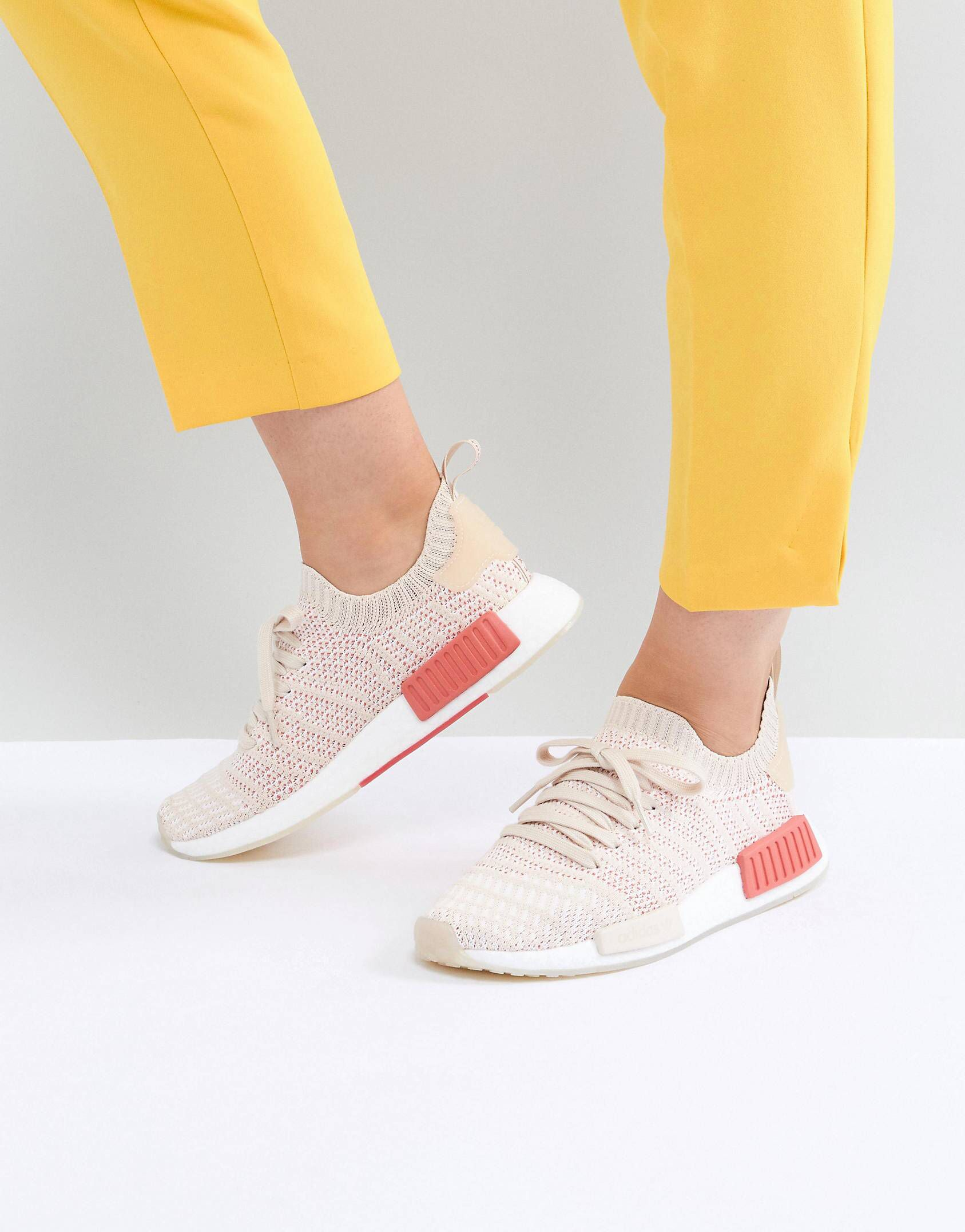 26c28effb adidas Originals NMD R1 Stealth Primeknit Trainers In Off White at asos.com