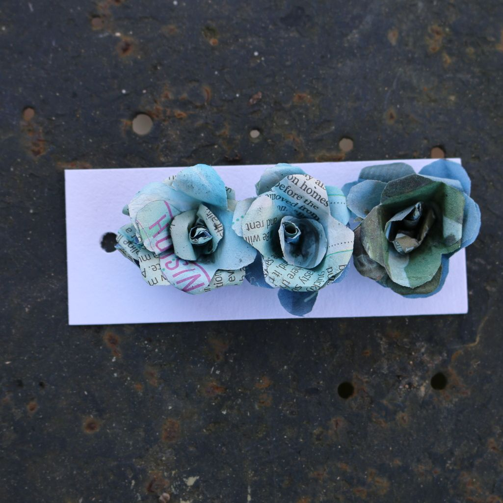 Blue tinted newspaper roses