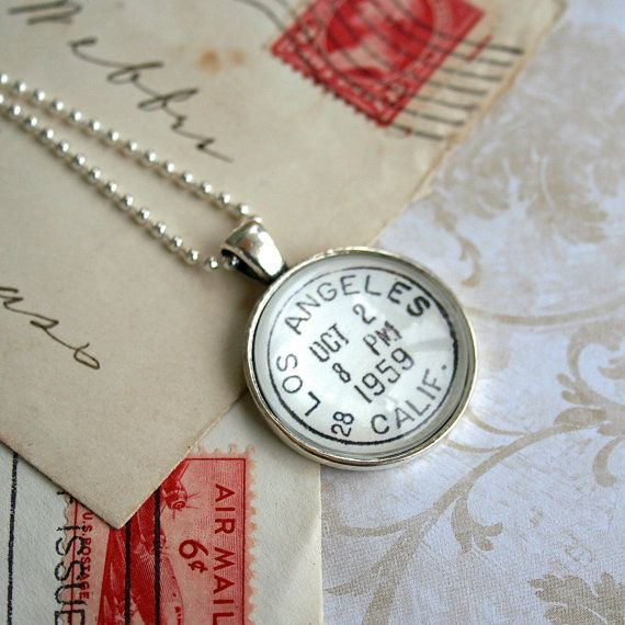 The city of angels :  Los Angeles Vintage Postmark Necklace, by CrowBiz.  Other great cities available now: New York, Boston, San Francisco, Washington DC, Brooklyn