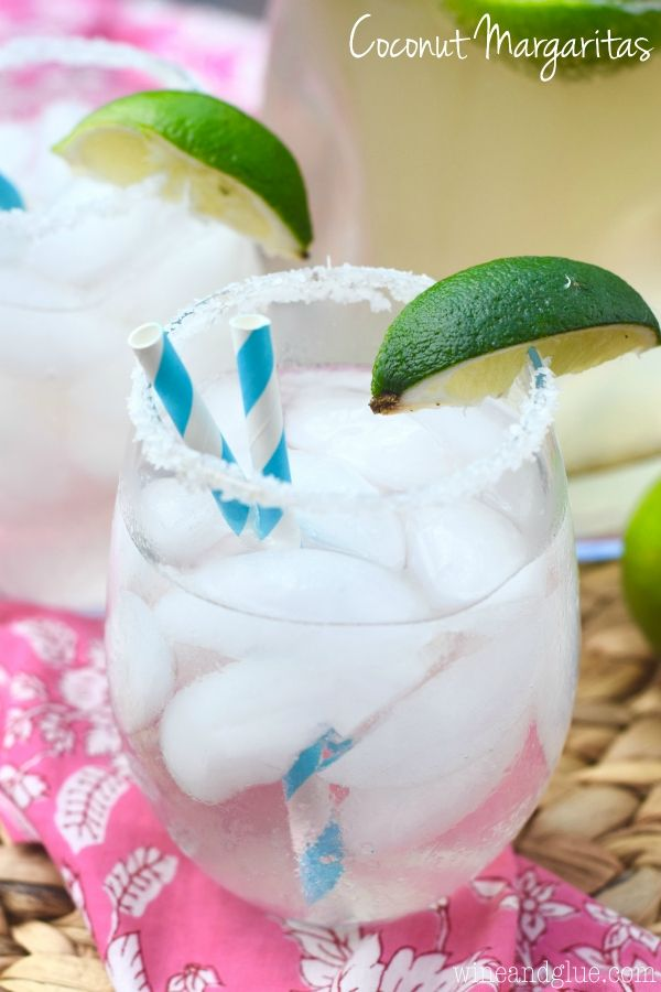 This Coconut Margarita - Not at all hard to make a whole pitcher of and will delight your guests!