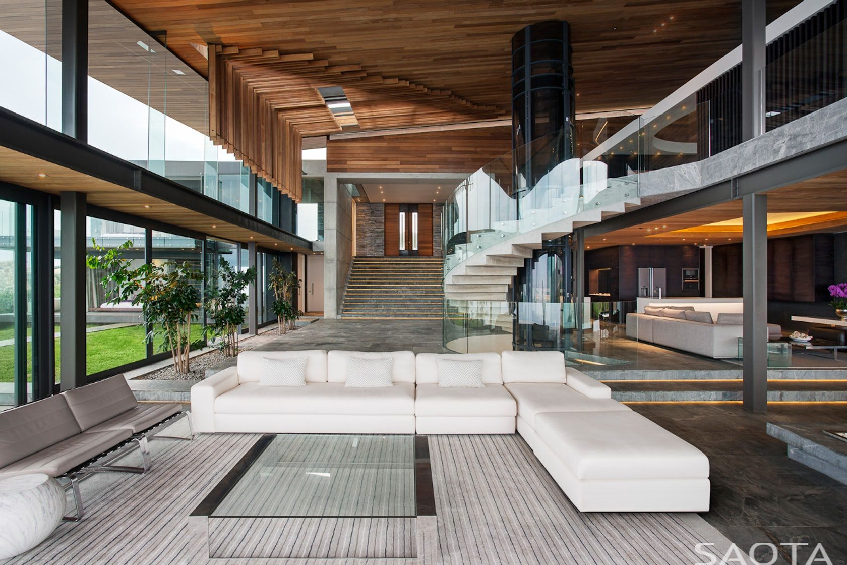 Best Open Double Height Living Area Combines Wood Stone And 400 x 300