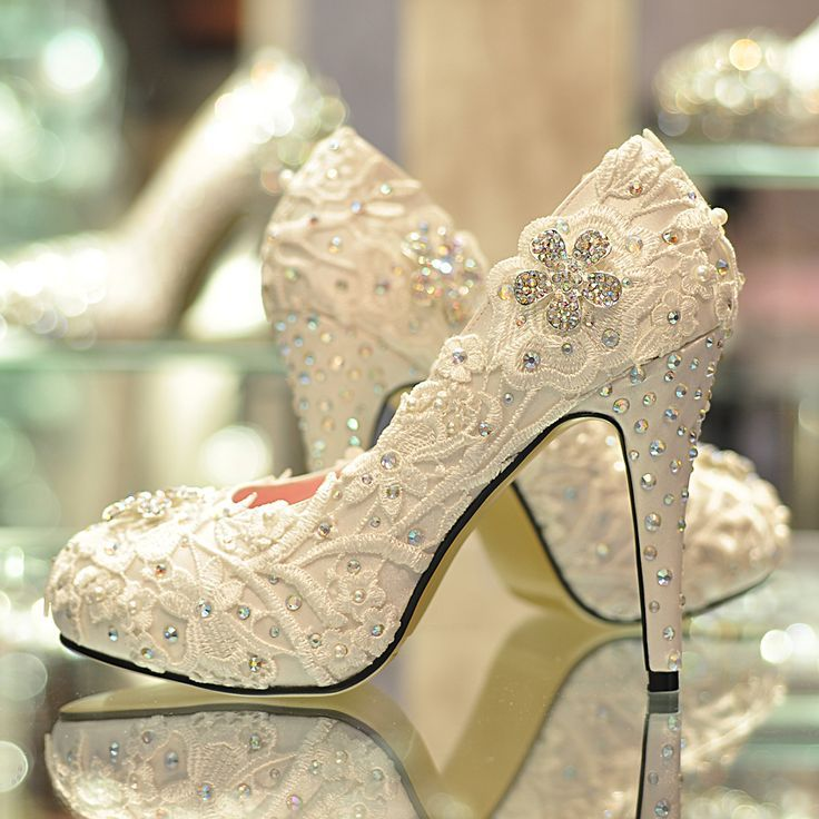 White Wedding Shoes Encrusted With Jewels