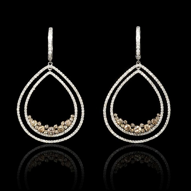 This lovely pair of 18k white and yellow gold earrings, feature 306 round brilliant cut white diamonds, of F color, VS2 clarity, of excellent cut and brilliance, weighing 2.29 carats total with 34 round cut cognac diamonds, weighing 1.47 carats total