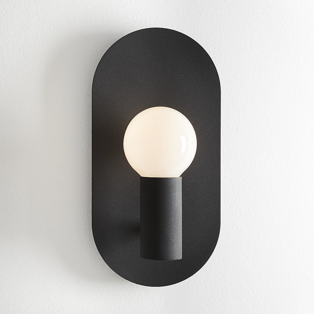 Shop Plate Matte Black Wall Sconce Matte Black Metal Oval Spotlights A Single Bulb Designed By Mermelada E Black Wall Sconce Modern Wall Sconces Wall Sconces