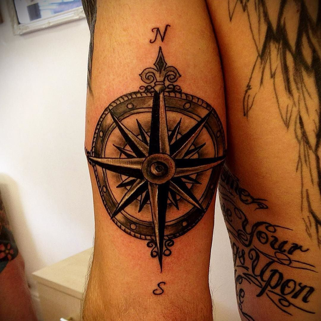 Nautical compass rose tattooed on the tricep. Not the best picture ...