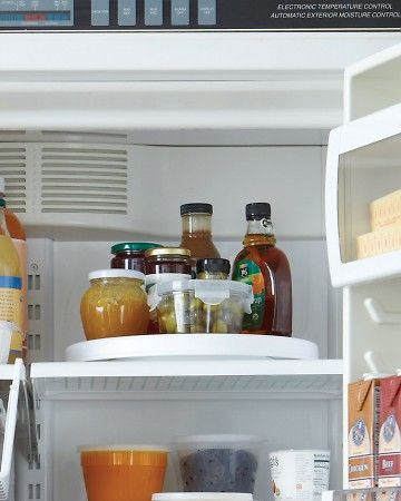 """Lazy susan in the fridge -- brilliant for all those little jars that get pushed to the back! May prevent the """"Honey, I don't see it!"""" syndrome :)"""