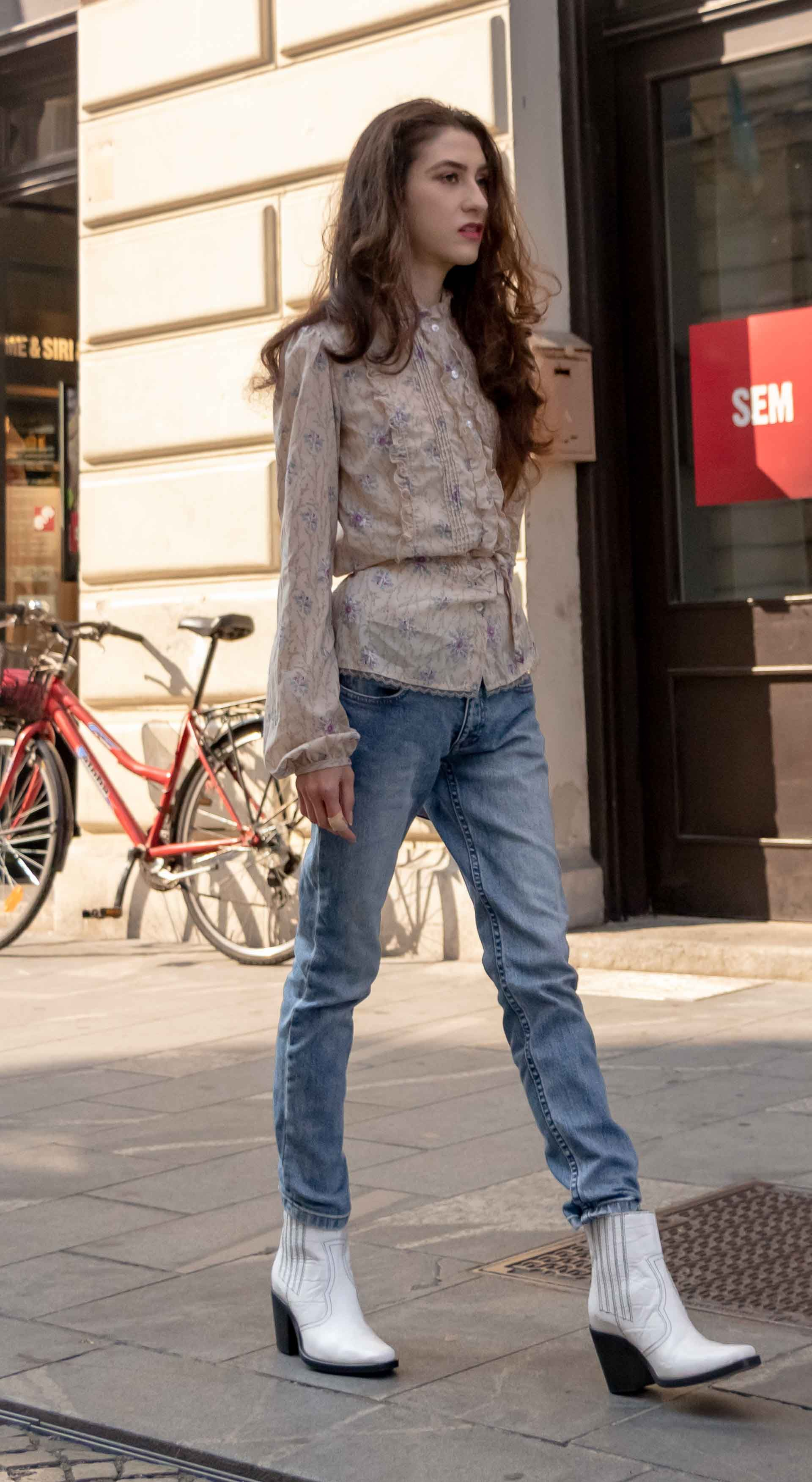 5051511a589 Beautiful Slovenian Fashion Blogger Veronika Lipar of Brunette from Wall  dressed in white Ganni Western boots