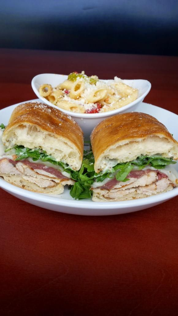 Albero Cafe -  Hungry?  Try our Chicken Saltimbocco sandwich.  Served with either our house-made chips or our famous pasta salad.
