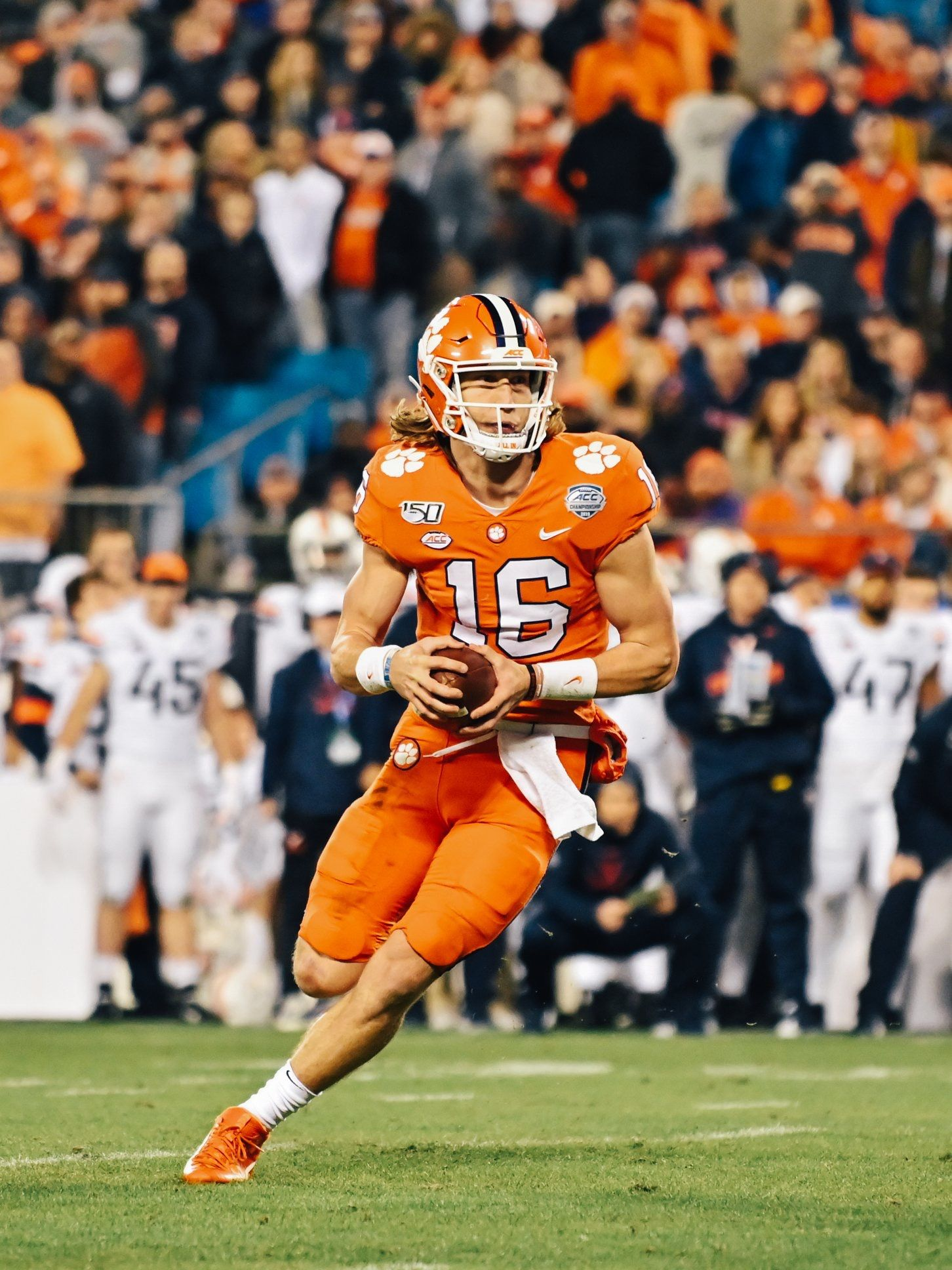 Quarterback Trevor Lawrence rushes up field against