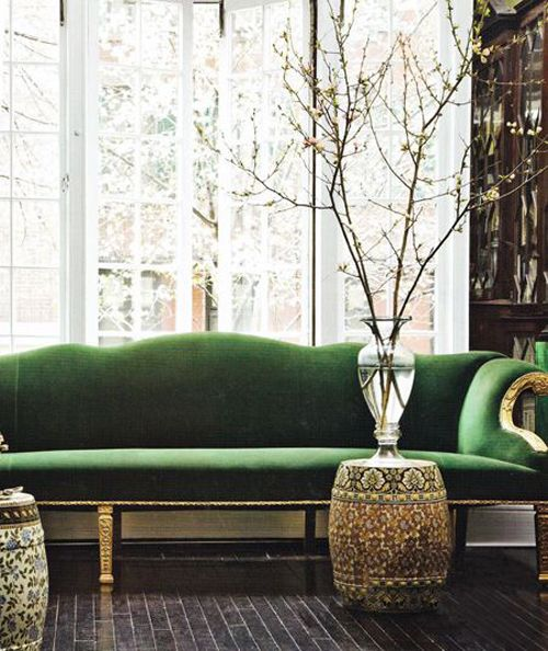 green velvet couch, dark wood cabinetry and floors, big bay windows ...