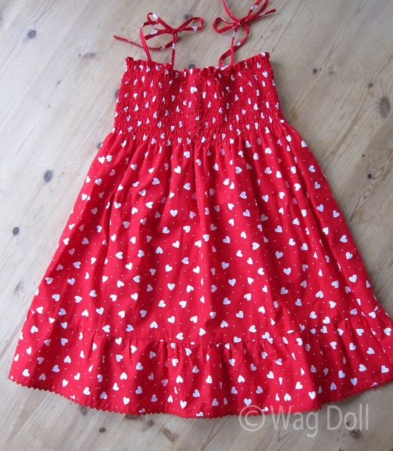 a574150d332 Girls Cotton Dress with shirring and ruffles from Wag Doll. Nice tutorial  with lots of photos.