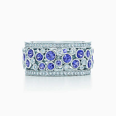 Just $12,000 (ha) Tiffany Cobblestone band ring in platinum with diamonds, 9.5 mm wide.