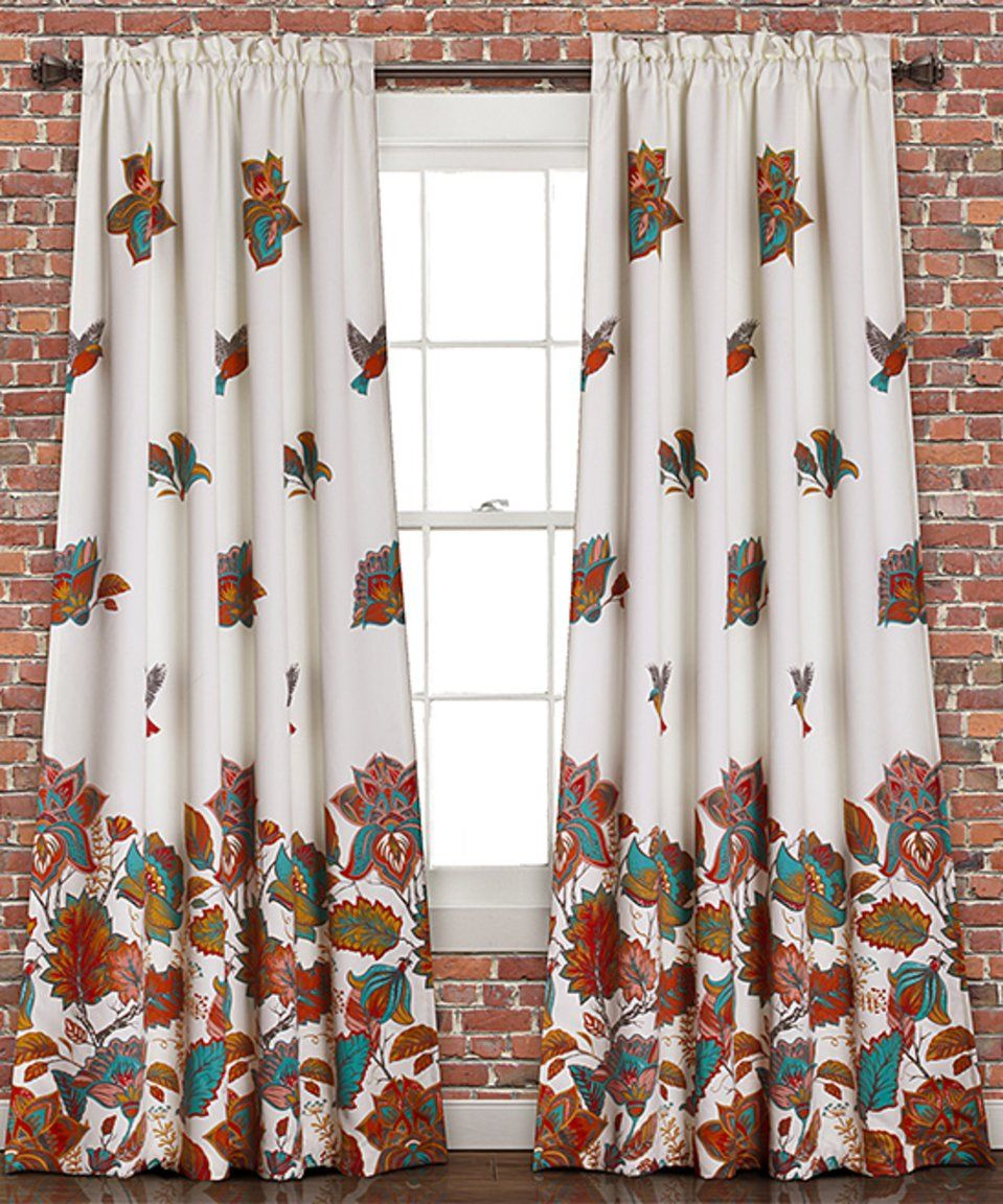 Take a look at this white floral bird roomdarkening curtain panel