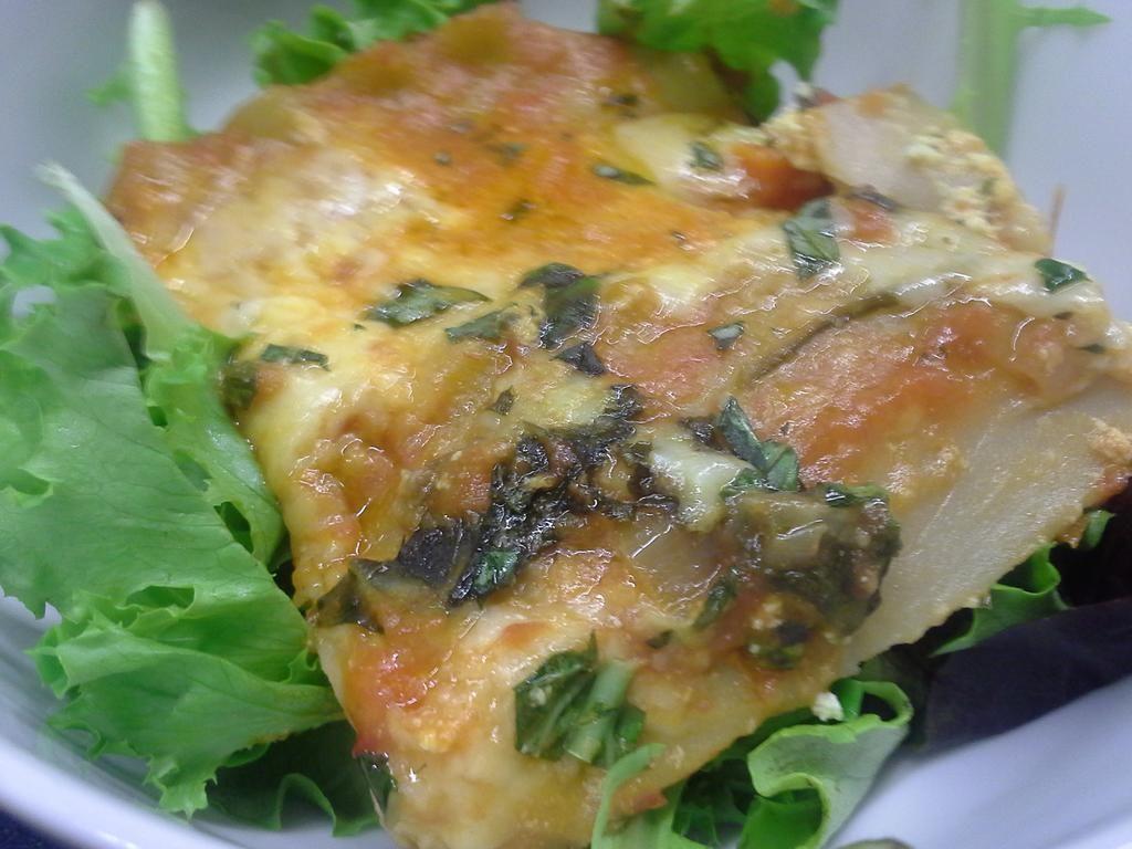 Gluten-free lasagna made with herbed ricotta, fresh mozzarella, mushrooms, & kale.