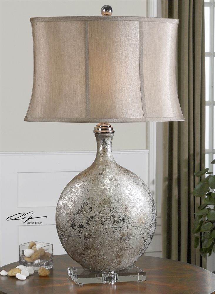 Navelli table lamp features a metallic silver ceramic base with gray wash polished nickel plated accents and a crystal footed base