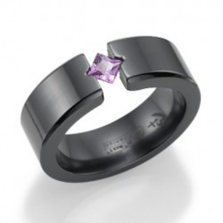 My future wedding ring. Black titanium and a pink sapphire. (yes this is a men's ring)
