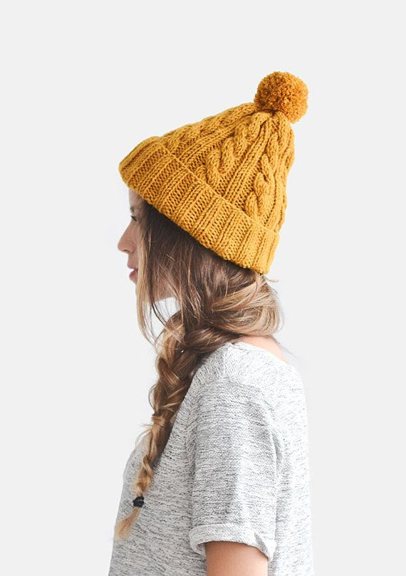 Handknitted unisex beanie hat with handmade pom pon. YARN  Wool blend.  COLORS  Here shown in mustard yellow. You can choose any of the colors  shown in c3ff1bc1604