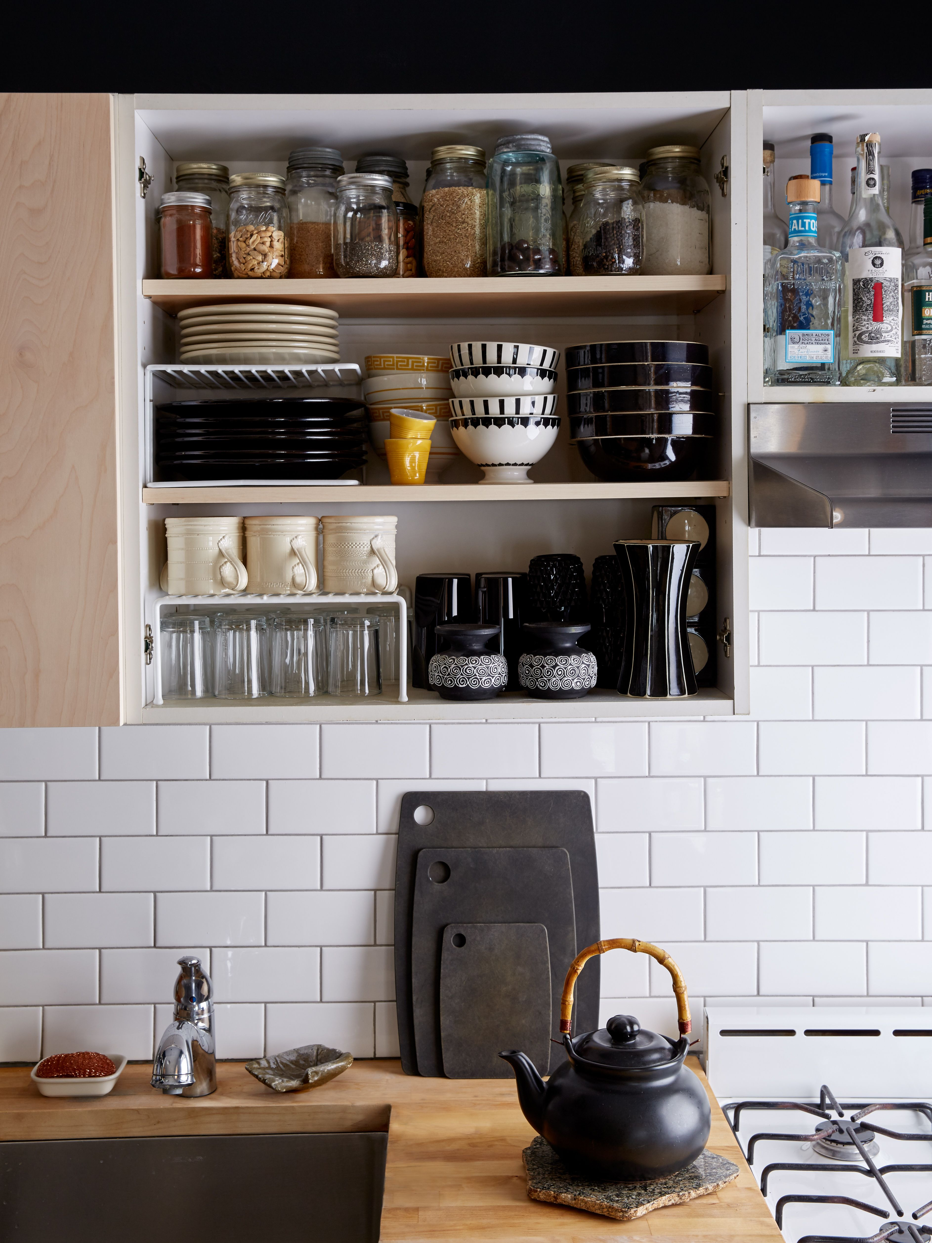 Open kitchen shelving and white subway tile backsplash