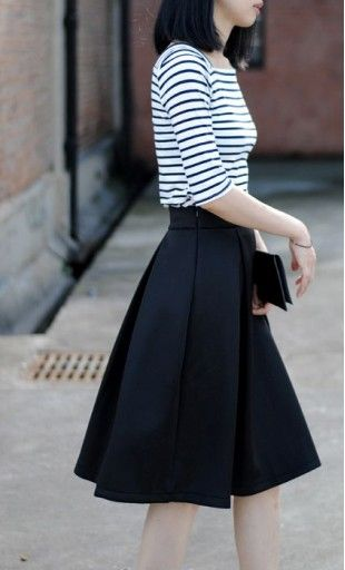 9a37e15dfd Womens modest vintage mid length skirts with a vintage pleated flare  available in navy, red and black S-L.