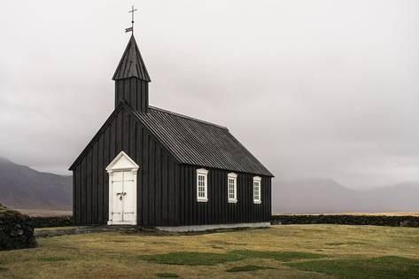 Photographic Print: Snaefellsnes peninsula, Iceland, Europe. The small black church in Budir. by Andrea Papaleo : 36x24in