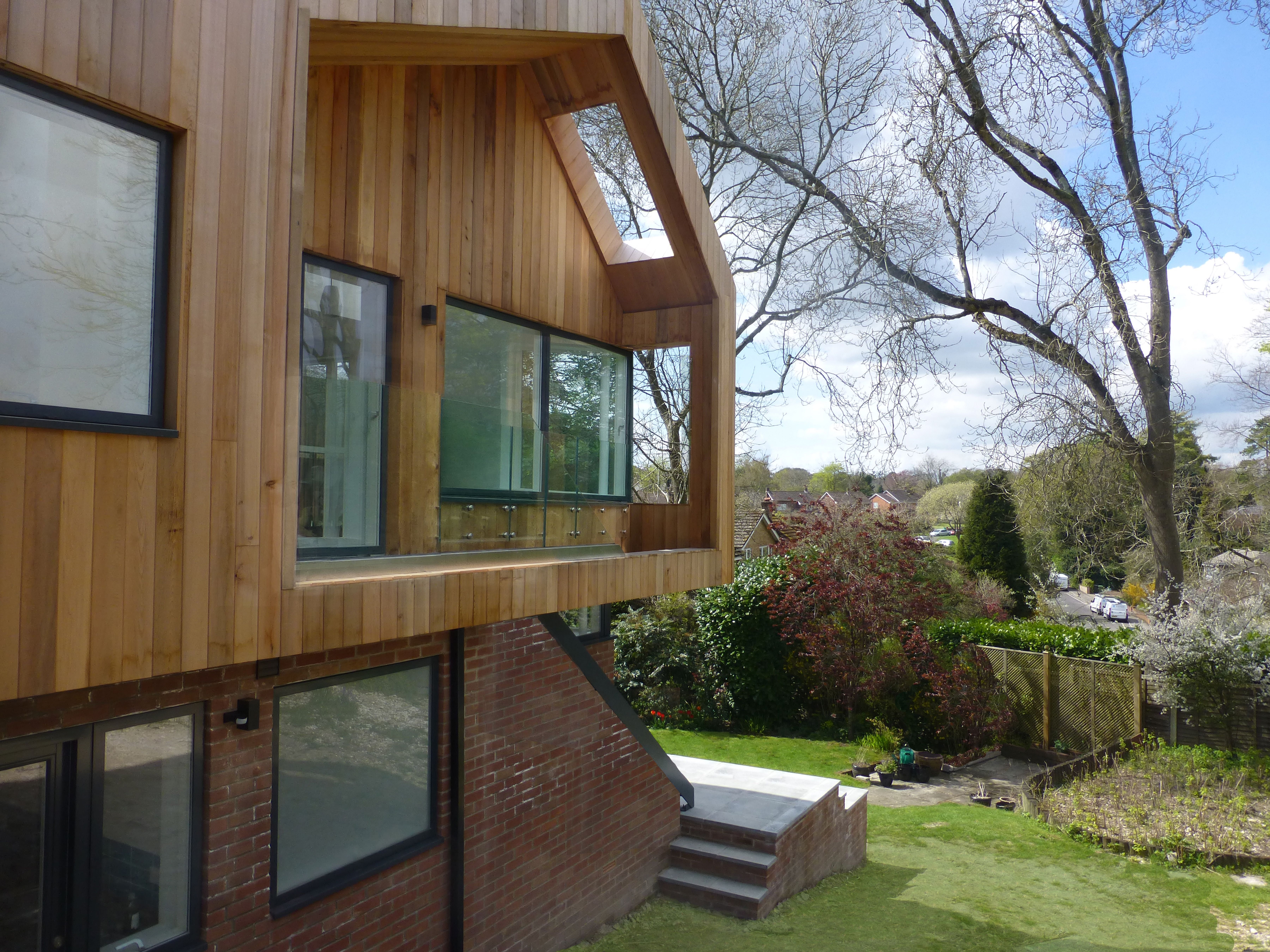 Two Storey Timber Clad Extension With Cantilever