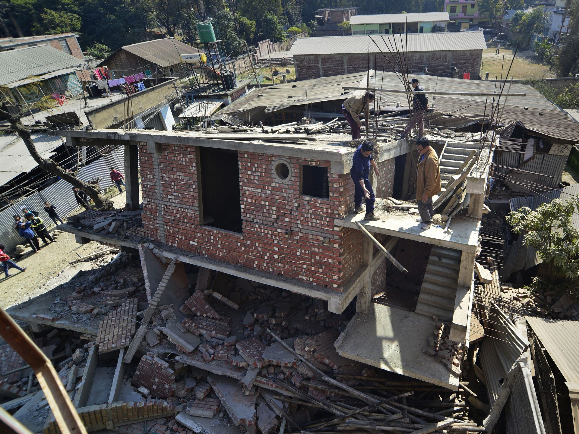 A damaged building after a magnitude-6.7 earthquake struck, in Imphal, India.  European Pressphoto Agency