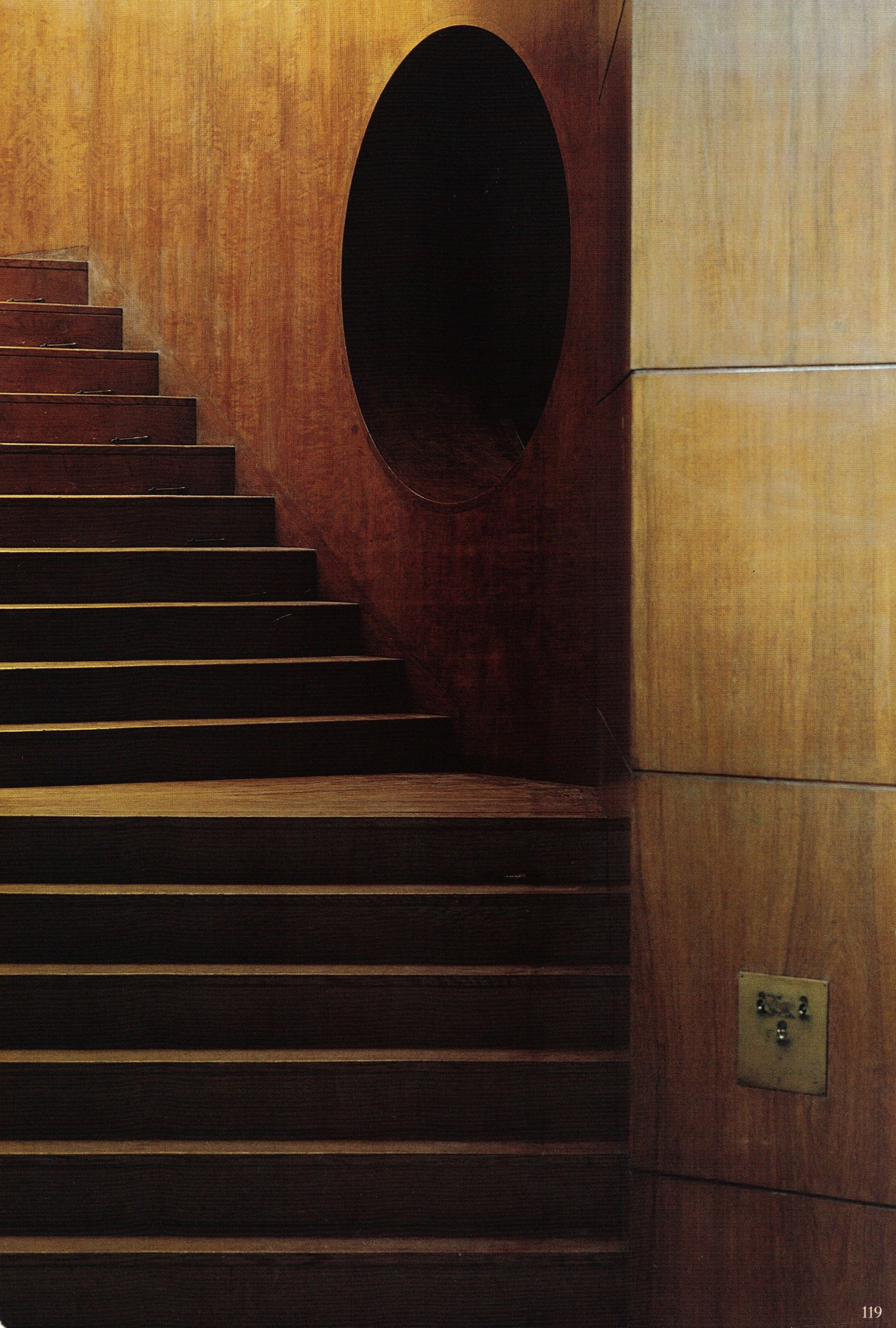 Eltham Palace Art Deco extension, photo of staircase, one of two symmetrical, walls in Australian black bean wood, decorative porthole. From World of Interiors June 1999 http://www.worldofinteriors.co.uk/  see also http://www.english-heritage.org.uk/visit/places/eltham-palace-and-gardens/things-to-do/#Section3