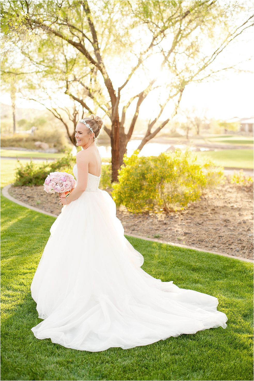 Romantic strapless wedding gown in a light blush color with bridal